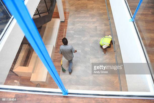 Workers put on the finishing touches in the reception area of the openconcept Sanderson Apartments by Mental Health Center of Denver a threestory...