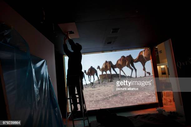 Workers put the final touches at the stall of Qatar at the ITB travel fair in Berlin, Germany, 06 March 2018. Photo: Carsten Koall/dpa
