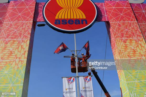 Workers put up flags enroute to the Philippine International Convention Center the venue of the upcoming the 31st Association of Southeast Asian...
