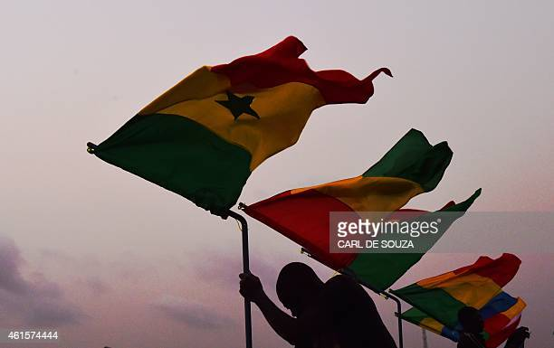 Workers put up flags of African countries competing in the Africa Cup of Nations near Bata stadium in Bata Equatorial Guinea on January 15 2015 The...