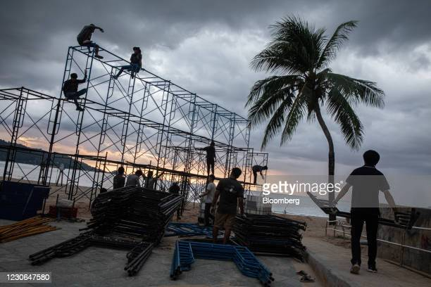 Workers put up scaffolding near Patong Beach in Patong, Phuket, Thailand, on Saturday, Dec. 19, 2020. The tepid response to Thailands highly...