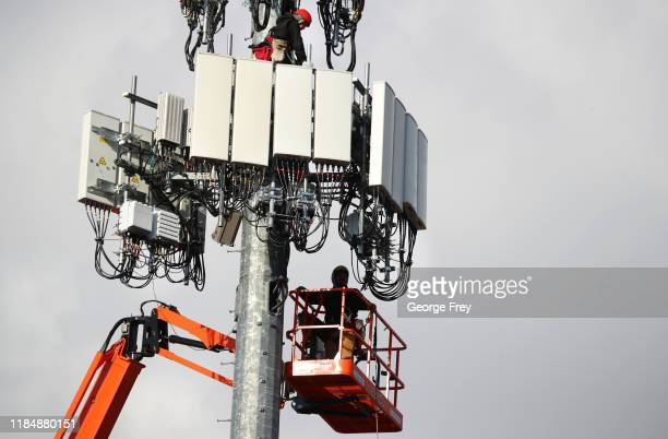 Workers rebuild a cellular tower with 5G equipment for the Verizon network on November 26 2019 in Orem Utah The new 5G networks that are coming soon...