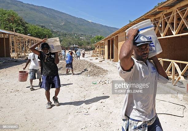 Workers rebuild the destroyed College St Jean l'Evangeliste in PortauPrince on April 5 2010 as schools reopen following the January 12 earthquake...