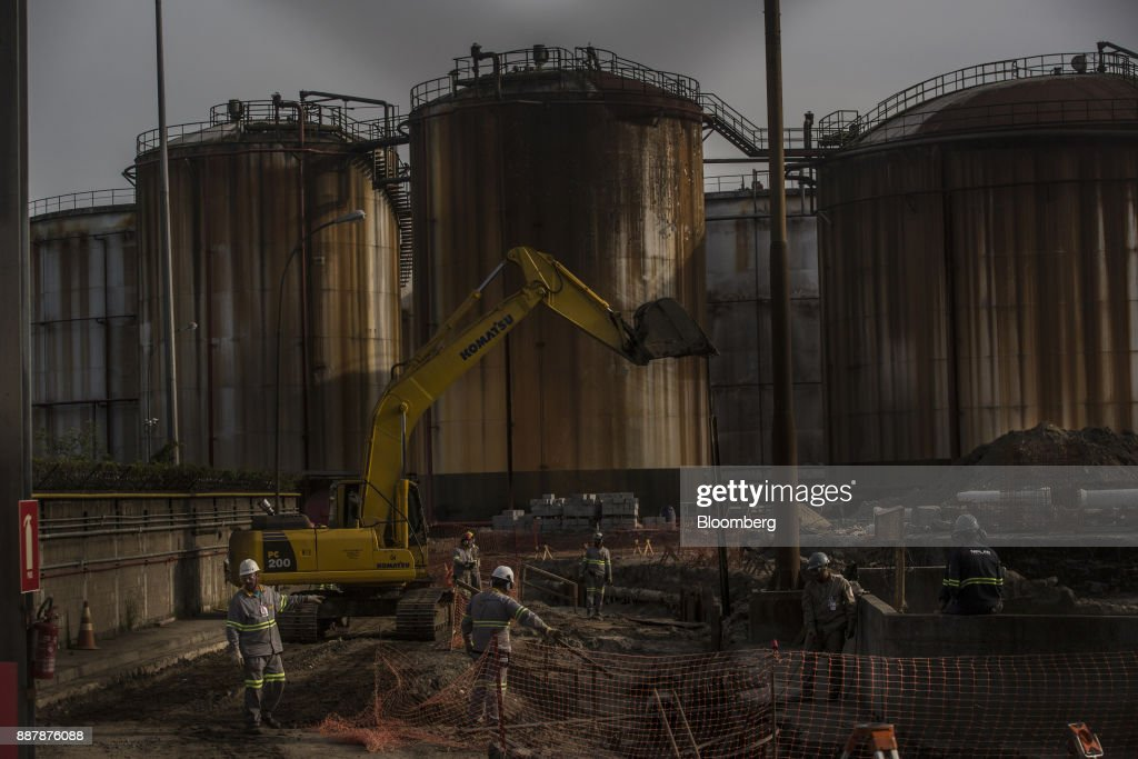 Workers rebuild the site of a 2016 fuel-tank fire at the Port of Santos in Santos, Brazil, on Thursday, Oct. 5, 2017. The port complex is a 3-square-mile microcosm of a country buffeted by political turmoil, drug-fueled violence and persistent income inequality as it emerges from a grinding recession. Photographer: Dado Galdieri/Bloomberg via Getty Images