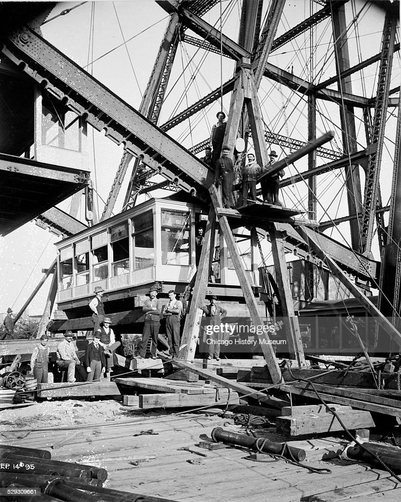 Workers reconstructing the Ferris wheel on North Clark Street near Wrightwood Avenue, Chicago, Illinois, 1895. This was the first Ferris wheel, originally constructed at the World's Columbian Exposition in 1893.