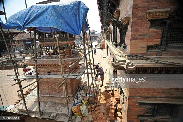 Workers reconstruction monuments at Bhaktapur Durbar Square, Nepal on April 21, 2016. Most of old houses and monuments in Bhaktapur were badly...