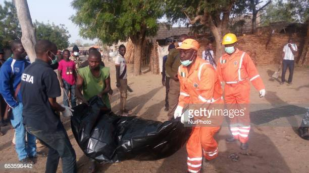 NEMA workers recovers bodies at Usmanti along Muna Garage Maiduguri Nigeria Four female teenage suicide bombers killed two people and injured 16...