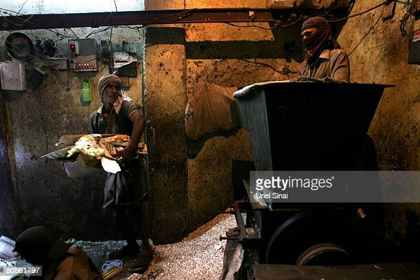 Workers recycling plastic at the Dharavi slum said to be 'Asia's largest slum' April 2008 in Mumbai India A city redevelopment program to convert...