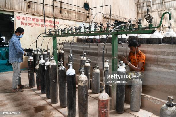 Workers refilling oxygen cylinders at an oxygen plant. Supply of medical oxygen to public hospitals is under strain as the demand for the...