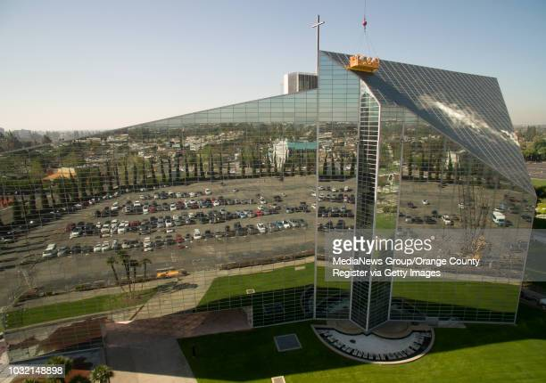 Workers refurbish the panes of glass on the roof of Christ Cathedral in Garden Grove on Wednesday The church formerly known as Crystal Cathedral is...