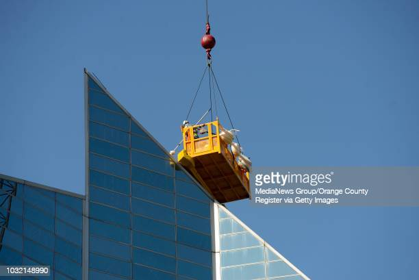 Workers refurbish the panes of glass on the roof of Christ Cathedral in Garden Grove on Wednesday. The church, formerly known as Crystal Cathedral,...