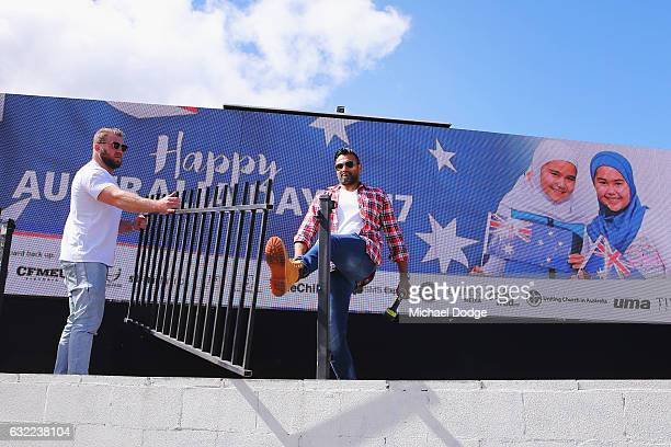 Workers reinstate an Australia Day Advertisement Featuring Girls In Hijabs on January 21 2017 in Melbourne Australia The original billboard of two...