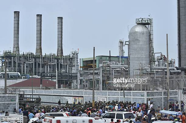 Workers relatives and security personnel gather at the entrance of the staterun oil giant Pemex's Pajaritos petrochemical plant in Coatzacoalcos...