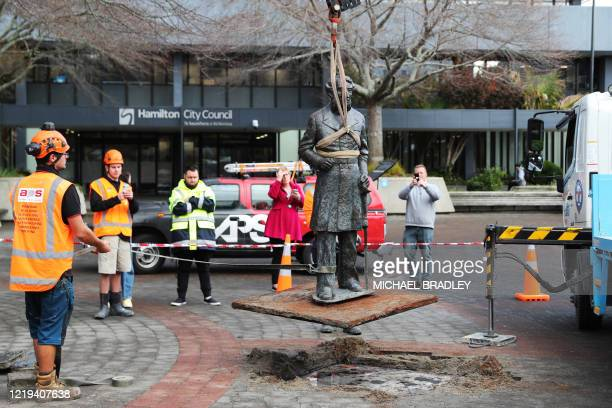 Workers remove a controversial statue of Captain John Fane Charles Hamilton from Civic Square in Hamilton on June 12 following a formal request by...