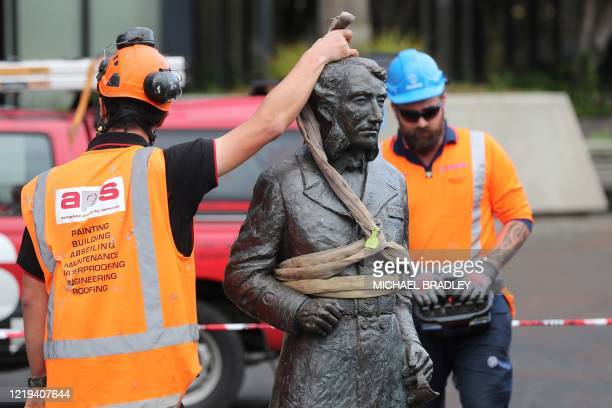 TOPSHOT Workers remove a controversial statue of Captain John Fane Charles Hamilton from Civic Square in Hamilton on June 12 following a formal...