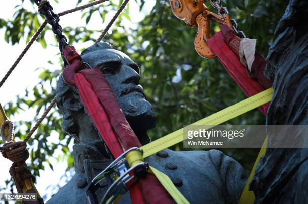 """Workers remove a statue of Confederate General Thomas """"Stonewall"""" Jackson from the Charlottesville and Albemarle County Courthouse Historic District..."""