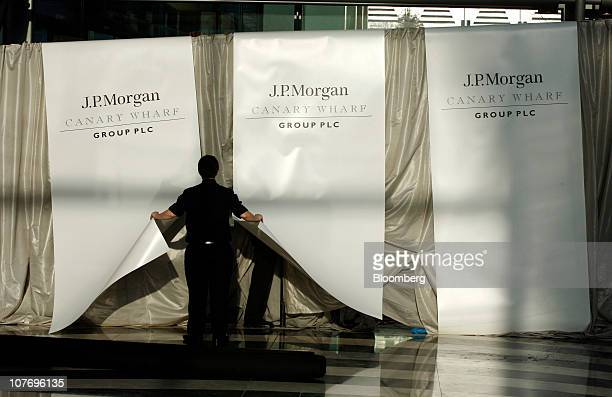 Workers remove branding for JPMorgan Chase Co from the former Lehman Brothers Holdings Inc building at Canary Wharf in London UK on Monday Dec 20...