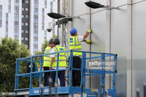 Workers remove cladding for testing from one of the tower blocks in Salford City on June 26 2017 in Salford England In the wake of the Grenfell Tower...