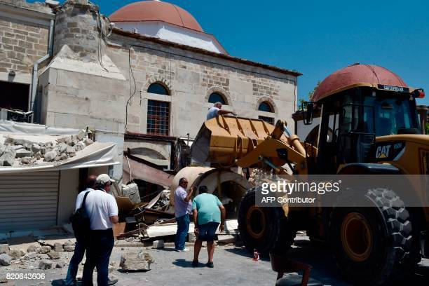Workers remove rubble from a quakedamaged mosque in the central square of the Greek Island of Kos on July 22 a day after a 65 magnitude earthquake...