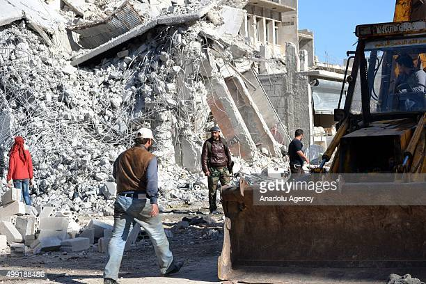 Workers remove the debris of a building following the Russian airstrikes targeting a market and residential areas in Ariha town Idlib northern Syria...