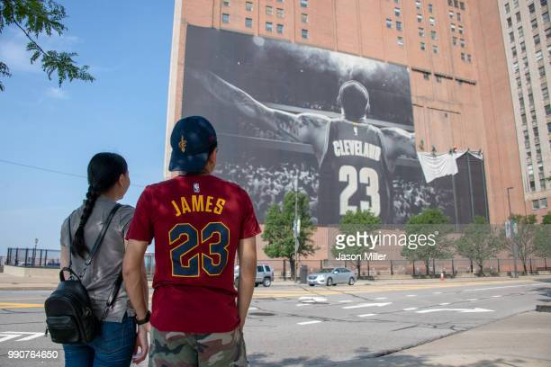 Workers remove the Nike LeBron James banner from the SherwinWilliams building near Quicken Loans Arena on July 3 2018 in Cleveland Ohio NOTE TO USER...