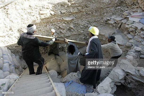 Workers remove the protection to the first tomb to be discovered in the Valley of the Kings since King Tut's in 1922 on February 10 2006 in Luxor...