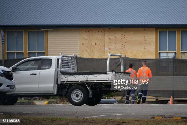 Workers repair a classroom wall at the Banksia Road Public School following a car crash inside the school's premises in Sydney on November 7 2017 Two...