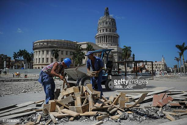 Workers repair a street near the Capitol in Havana on March 16 during preparations ahead of US President Barack Obama's visit The White House on...