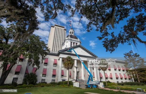 Workers repair the damage from Hurricane Michael to the historic Old Florida State Capitol building, which sits in front of the current New Capitol...