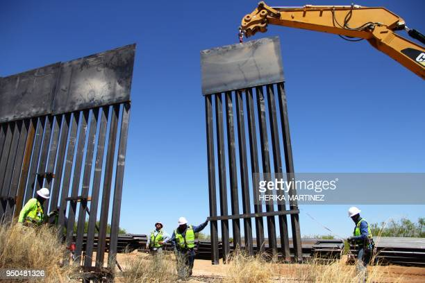TOPSHOT Workers replace an old section of the wall between the US and Mexico following orders by US President Donald Trump in Santa Teresa New Mexico...