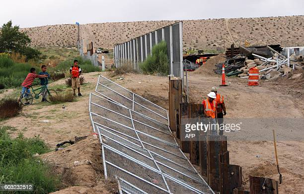 US workers replace fencing with a higher new metal wall along the border between Ciudad Juarez and Sunland Park New Mexico in Juarez Chihuahua state...