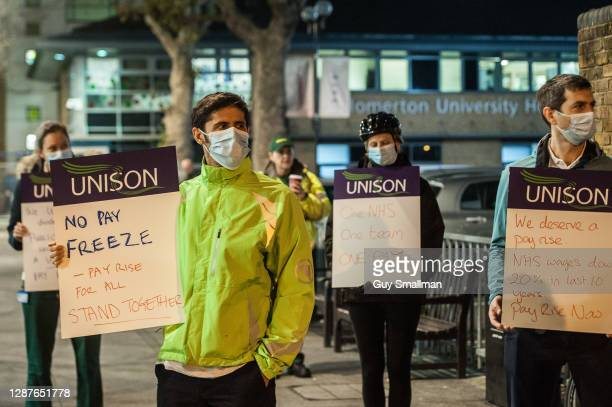 Workers represented by the UNISON Trade Union at Homerton Hospital protest against the public sector pay freeze announced by Chancellor of the...