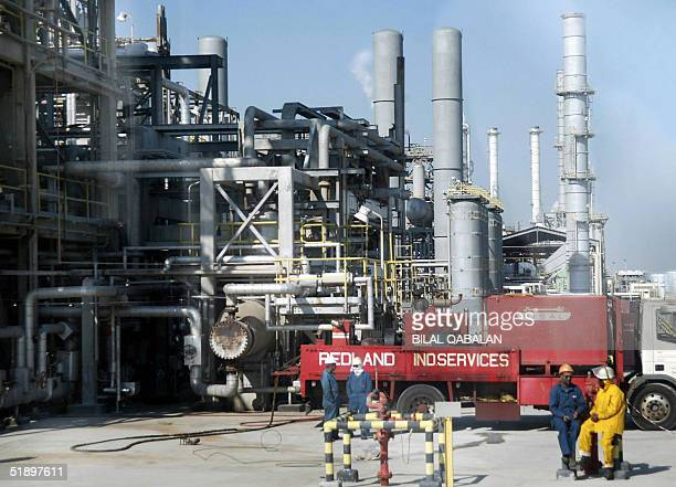 Workers rest at Ras Tannura's oil production plant near Dammam in Saudi Arabia's eastern province 27 December 2004 The world's number one producer...