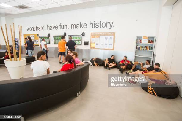 Workers rest on bean bags during a lunch break at the Amazoncom Inc fulfillment center in Passo Corese Rieti Italy on Thursday July 26 2018 Amazon...