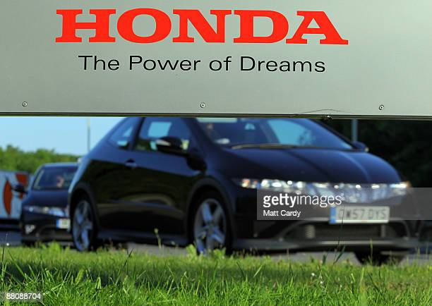 Workers return to work at the Honda factory after a four month shutdown on June 1 2009 in Swindon England The reopening of the plant which closed...