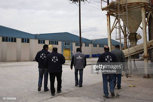 Workers return to work on 12 February 2013 for the first day of production under workers' control at the Viomichaniki Metalleutiki factory in...