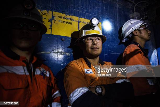 Workers ride an elevator up from the underground mining project at the Oyu Tolgoi coppergold mine jointly owned by Rio Tinto Group's Turquoise Hill...