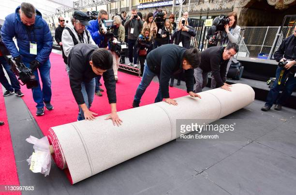 Workers roll out red carpet in preparation for the 91st Annual Academy Awards at Dolby Theatre on February 20 2019 in Hollywood California