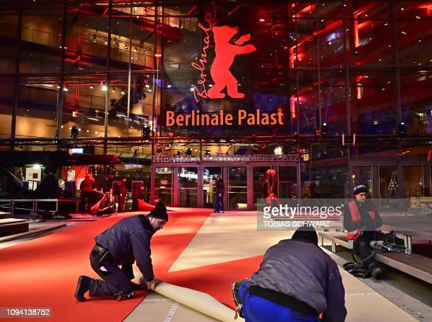 Workers roll out the red carpet as preparations are under way for the Berlinale international film festival in Berlin on February 5 2019 The Berlin...