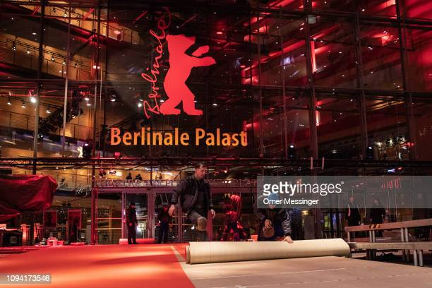 Workers roll out the red carpet at the Berlinale Palace prior to the 69th Berlinale International Film Festival on February 5 2019 in Berlin Germany...