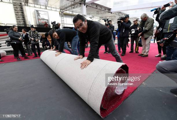 Workers roll out the red carpet in preparation for the 91st Academy Awards at Dolby Theatre on February 15, 2019 in Hollywood, California.