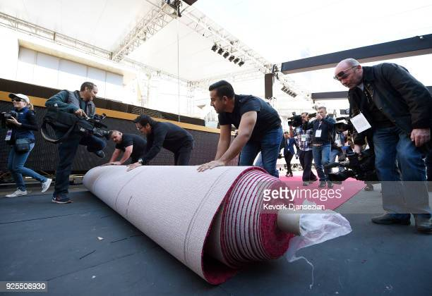 Workers rollout the red carpet in preparation for the 90th Academy Awards on February 28 2018 in Hollywood California