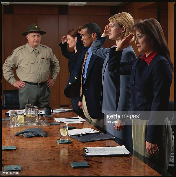 Workers Saluting Supervisor Dressed as a Drill Sergeant