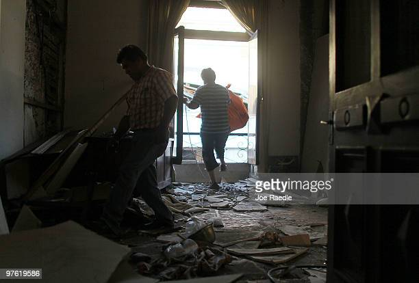 Workers salvage what they can from a home that was damaged during the February 27th earthquake March 10, 2010 in Concepcion, Chile. Food, water and...