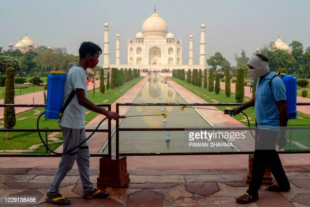 Workers sanitize the premises of Taj Mahal as a preventative measure against the Covid-19 coronavirus in Agra on October 18, 2020.