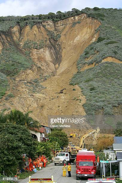 Workers search for victims of a mudslide that left four people dead and 20 missing January 11 2005 in La Conchita California Twelve homes were...
