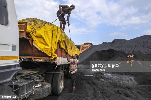 Workers secure a tarp on a truck laden with coal at Krishnapatnam Port in Krishnapatnam Andhra Pradesh India on Friday Aug 11 2017 Growth in gross...