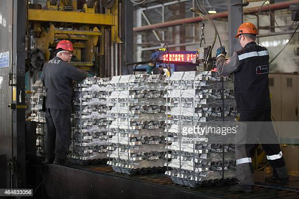 Workers secure stacks of aluminium ingots in the foundry at the Khakas aluminium smelter operated by United Co Rusal in Sayanogorsk Russia on...