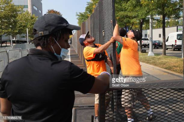 Workers secure the perimeter as they prepare for the first presidential debate between US President Donald Trump and Democratic presidential nominee...