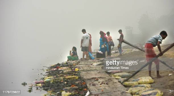 Workers seen cleaning after Chatth Puja, near a bank of Yamuna river, ITO, Vikas Marg, on November 3, 2019 in New Delhi, India. The air quality index...